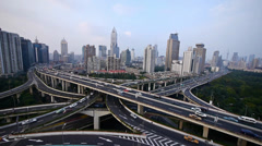 time lapse,heavy traffic on highway interchange,Aerial View of Shanghai Skyline - stock footage