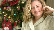 Stock Video Footage of Portrait of a smiling woman and christmas tree