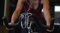 Toned Female Athlete Riding Bike (dolly shot) Stock Footage