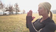 Beautiful caucasian performing yoga in sunlight - stock footage
