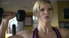 Close up of female athlete lifting weights overhead - stock footage