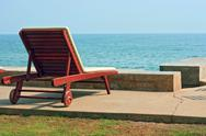 Stock Photo of lonely chair on hua-hin beach thailand. hua-hin is one of the most favorite c