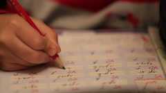 Close up little child doing homework Stock Footage