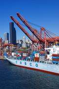 Container ship and dockyard cranes, seattle waterfront Stock Photos