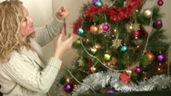 Stock Video Footage of Woman decorating the christmas tree