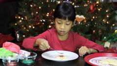 Asian Girl Adds Sprinkles To Her Christmas Cookie Stock Footage