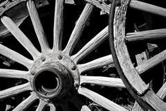 old wood wagon wheels - stock photo