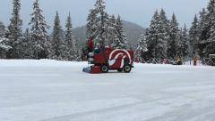 Outdoor Mountain Skating Rink Being Cleaned By Zamboni Stock Footage
