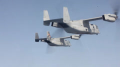 MV-22B Ospreys and  KC-130J Hercules conduct aerial refueling training Stock Footage