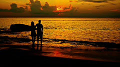 Silhouettes of  young man and girl Stock Footage