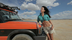 Adventure Girl on Land Rover in Desert Wilderness Tracking Stock Footage
