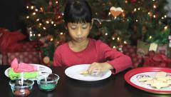 Girl Decorating Star Shaped Christmas Cookie Stock Footage