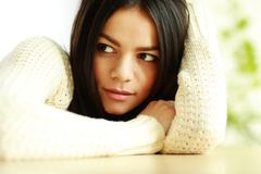 Closeup portrait of a young pensive woman looking aside Stock Photos