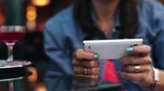Woman hands texting an sms in a restaurant Stock Footage