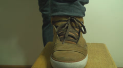 Young Man Unties Shoelace Front Shot Stock Footage