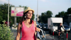 Woman walking along the city street Stock Footage