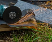 Stock Photo of sharpening and cutting by abrasive disk machine
