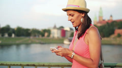 Woman using the cellphone and walking through the bridge Stock Footage