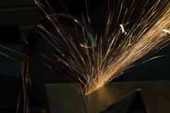 Sharpening and cutting by abrasive disk machine Stock Photos