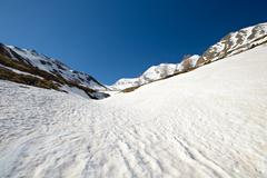 high altitude snow melting pattern - stock photo