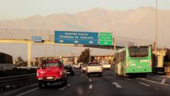 Handheld shot with Andes mountain on background during highway travel and sunset Stock Footage