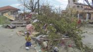 Stock Video Footage of Destruction Streets Of Tacloban After Typhoon Haiyan