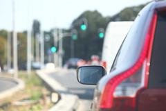 Car within traffic jam in rush hour highway in city Stock Photos