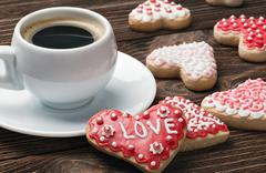baked on valentines day and a cup of coffee - stock photo