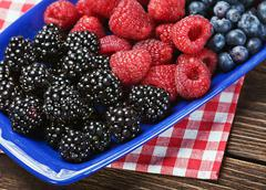 Fresh blackberries, raspberries and blueberries Stock Photos