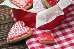 Cookies in a box in the form of baked hearts Stock Photos
