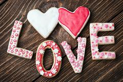 hearts and the word love of cookies for the holiday valentine's day - stock photo