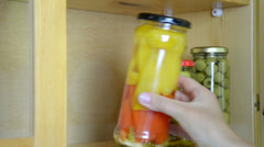 Hand puts jars marinated olives hot pepper red yellow pepper Stock Footage