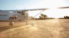 A Cessna-Type Single Engine Airplane taking off a farm airport Stock Footage