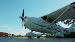 A Cessna-Type Single Engine Airplane turning on its engine Stock Footage