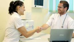 Doctor telling great news to happy female patient HD Stock Footage