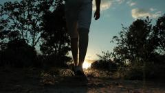 Young explorer man walking in the jungle Stock Footage