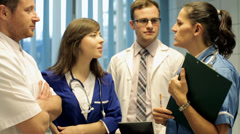 Happy, cheerful team of young happy, friendly doctors HD Stock Footage