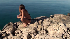 Pregnant prays near the sea Stock Footage