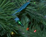 Stock Photo of Christmas Tree Branches With Lights