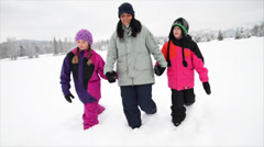 Mom and Kids Walk in Snow in Winter - stock footage