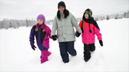Stock Video Footage of Mom and Kids Walk in Snow.