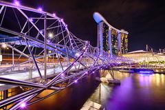 The Helix bridge with Marina Bay Sands in background Stock Photos