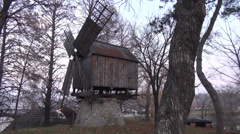 Old wind mill in traditional village, architecture, open air museum, zoom in Stock Footage