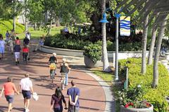 People walking and biking at riverwalk Stock Photos