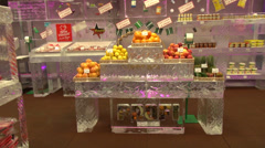 Ice store, shop made of ice, fresh fruits on ice shelves, blocks, ice carving Stock Footage