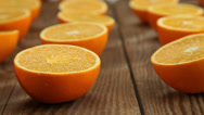 Stock Video Footage of Orange fruits on wood