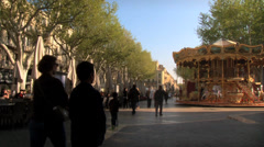 Avignon Carousel and outdoor restaurant Stock Footage