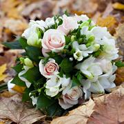 the wedding bunch of flowers lies on fallen leaves. - stock photo
