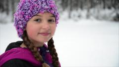 Happy Young Girl Smiles at Camera in Winter Stock Footage