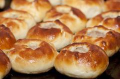 Pasties on baking tray Stock Photos